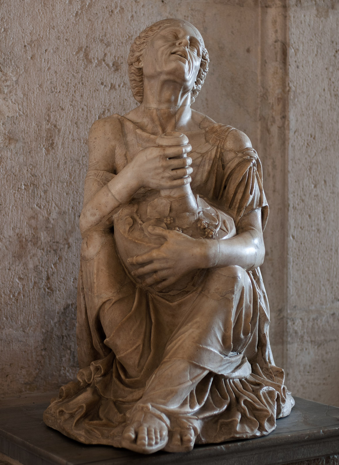Drunken old woman. Marble. Roman copy after a Hellenistic original of the end of the 3rd cent. BCE (restored with head of modern work).  Inv. No. MC 299. Rome, Capitoline Museums, Palazzo Nuovo, Gallery
