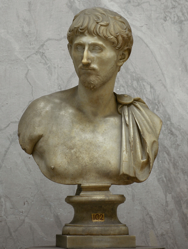 Roman male portrait bust. Fine-grained yellowish marble. Age of Trajan (98—117 CE). Height 78 cm. Rome, Vatican Museums, Chiaramonti Museum, New wing, 102