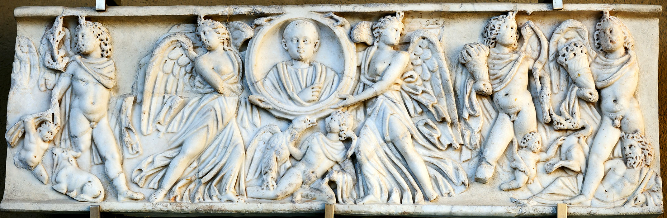 Front wall of sarcophagus with clipeus portrait (imago clipeata) of the deceased boy. Luni (Carrara) marble. 3rd century CE. Rome, National Museum of Palazzo Venezia