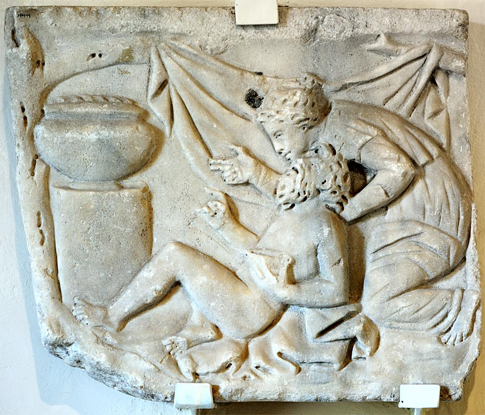 Silen and maenad (a fragment of a scene of feast of Dionysus). A short wall of a sarcophagus. White marble. Mid-2nd cent. CE. Arezzo, Civic Archaeological Museum