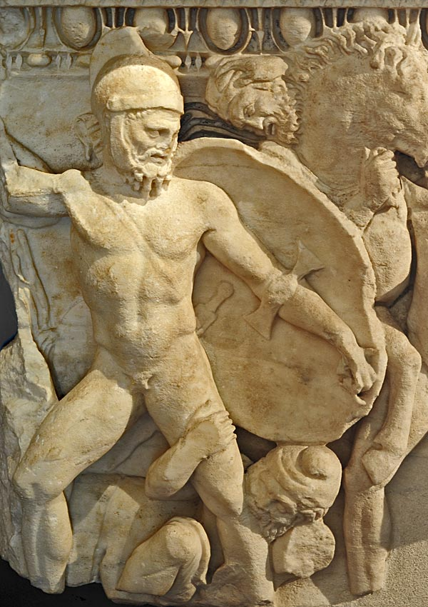 Sarcophagus with a scene of a naval battle. Detail: a thrown down warrier bites the enemy's leg. Apuan marble. 2nd century CE. Inv. No. MR 1. Brescia, Santa Giulia Civic Museum