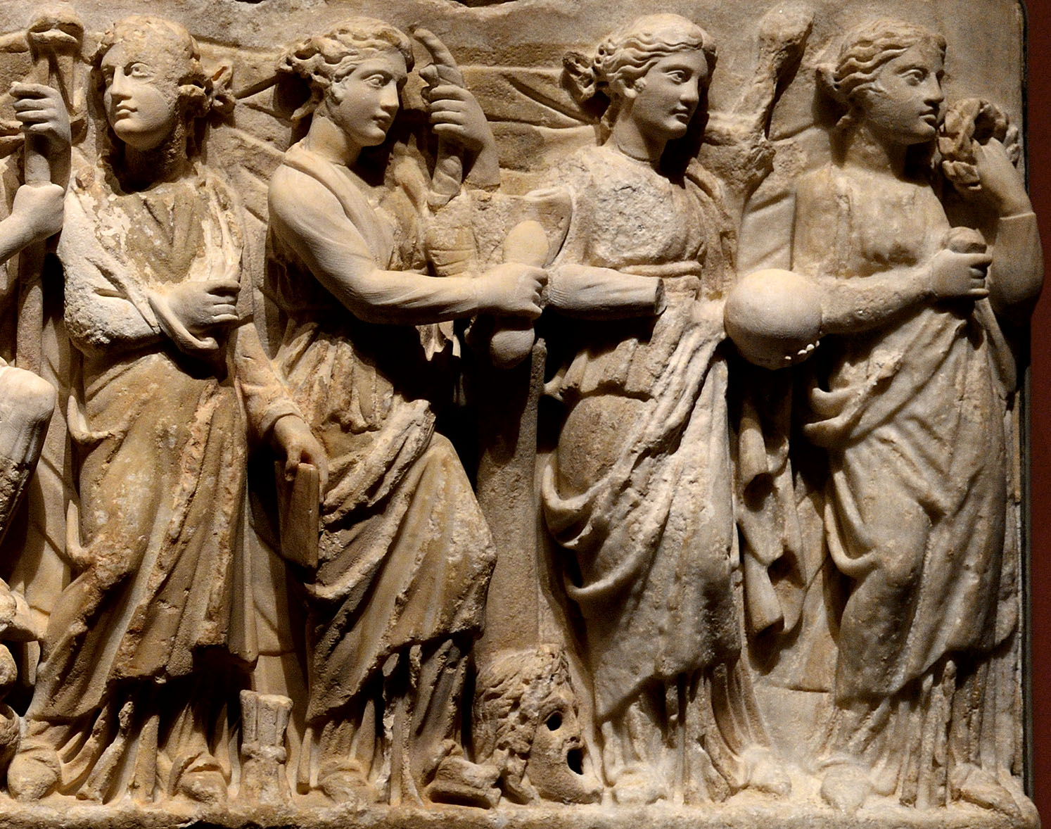 Nine Muses, Athena and Apollo. Detail: Calliope, Terpsichore, Urania, Clio. Relief of the front wall of a sarcophagus. Marble. 2nd cent. CE. Inv. No. A 185. Saint Petersburg, The State Hermitage Museum