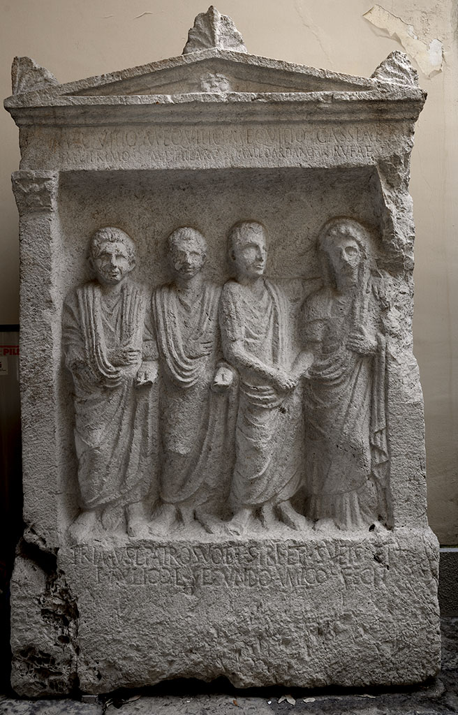 Tombstone of freedmen and their patron. First half of the 1st century CE. 167 × 103 × 42 cm. Letters 2—4 cm. Santa Maria Capua Vetere, Archaeological Museum of ancient Capua