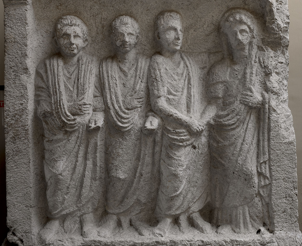 Tombstone of freedmen and their patron (close-up). First half of the 1st century CE. Santa Maria Capua Vetere, Archaeological Museum of ancient Capua