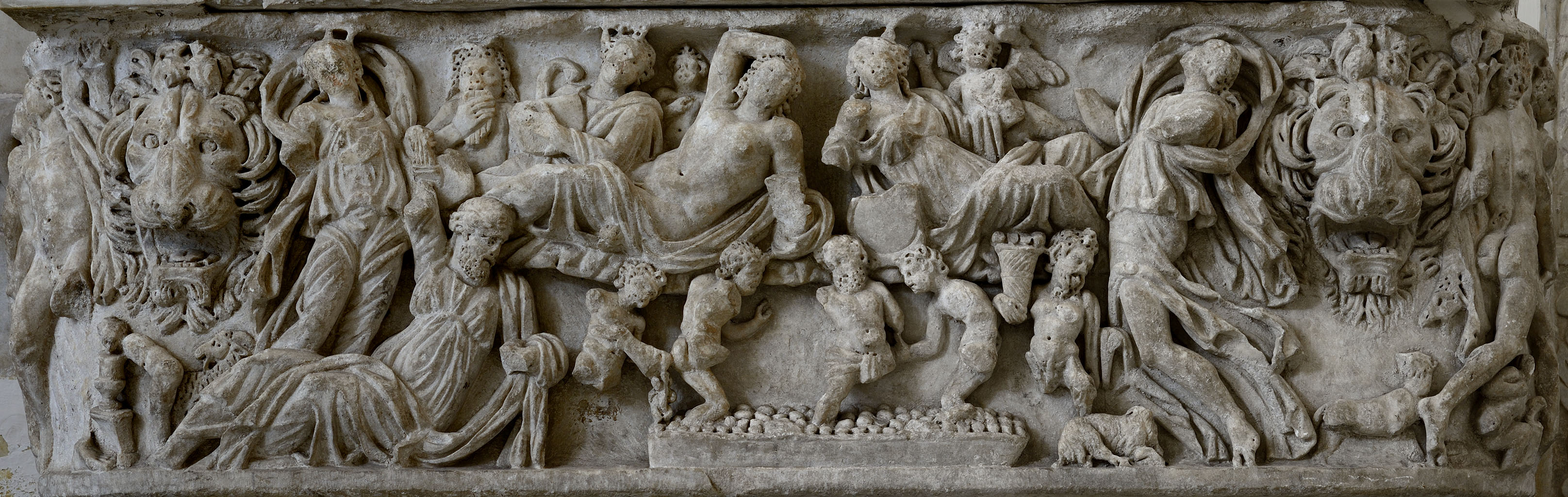 Dionysiac lenos-sarcophagus with the vintage scenes (the front panel). White marble. Beginning of the 3rd cent. CE. Salerno, Cathedral