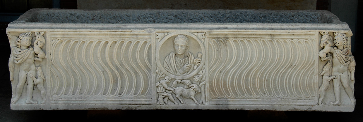 Sarcophagus strigilato with the Seasons and clipeus portrait of the deceased. Marble. 270s CE.  Inv. No. 1163. Ostia, Archaeological Museum