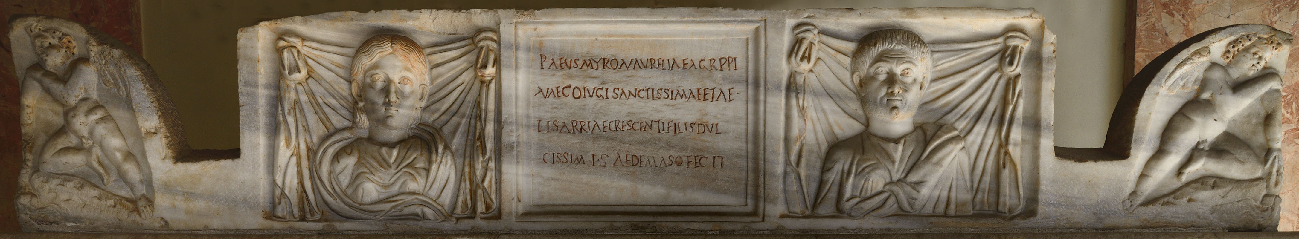 Lid of a sarcophagus of Paeus (Publius Aelius?) Myron and his family. Marble. 3rd century CE. Inv. No. 932. Rome, Vatican Museums, Pius-Clementine Museum, Octagonal Court, Nord portico, 27