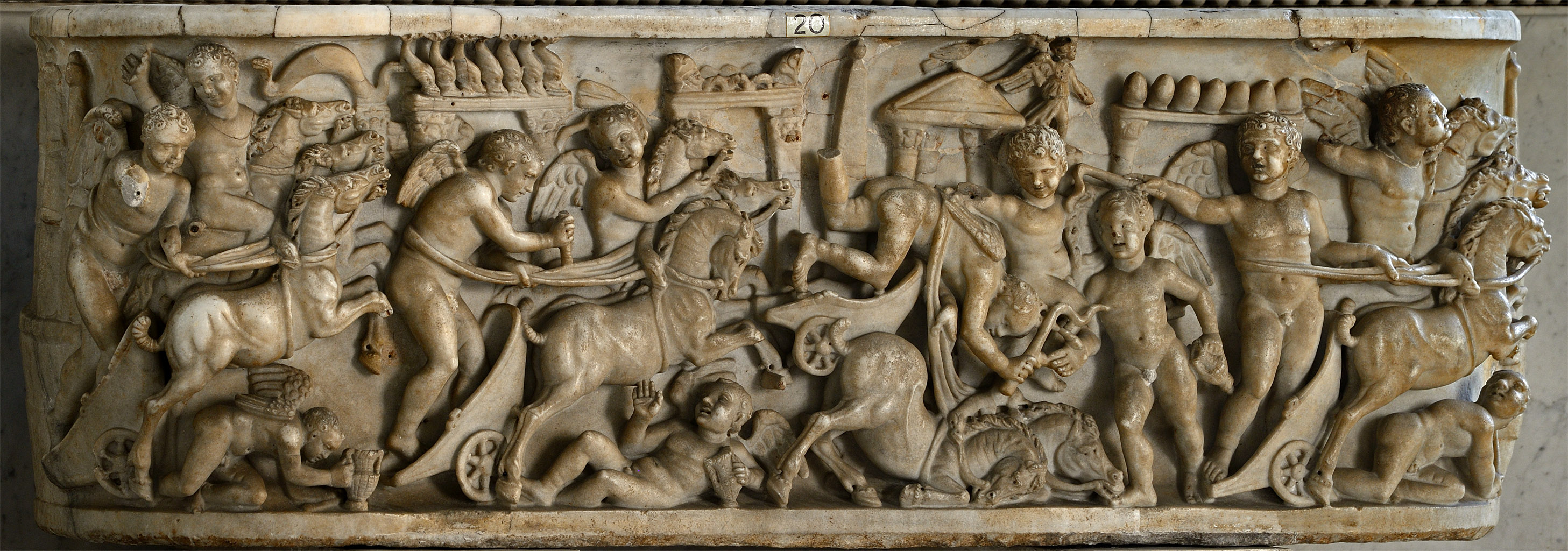 Lenos sarcophagus of a child with a chariot race of Amors (front panel). Marble. 130—192 CE. Inv. No. 2348. Rome, Vatican Museums, Pius-Clementine Museum, Room of the Biga, 20