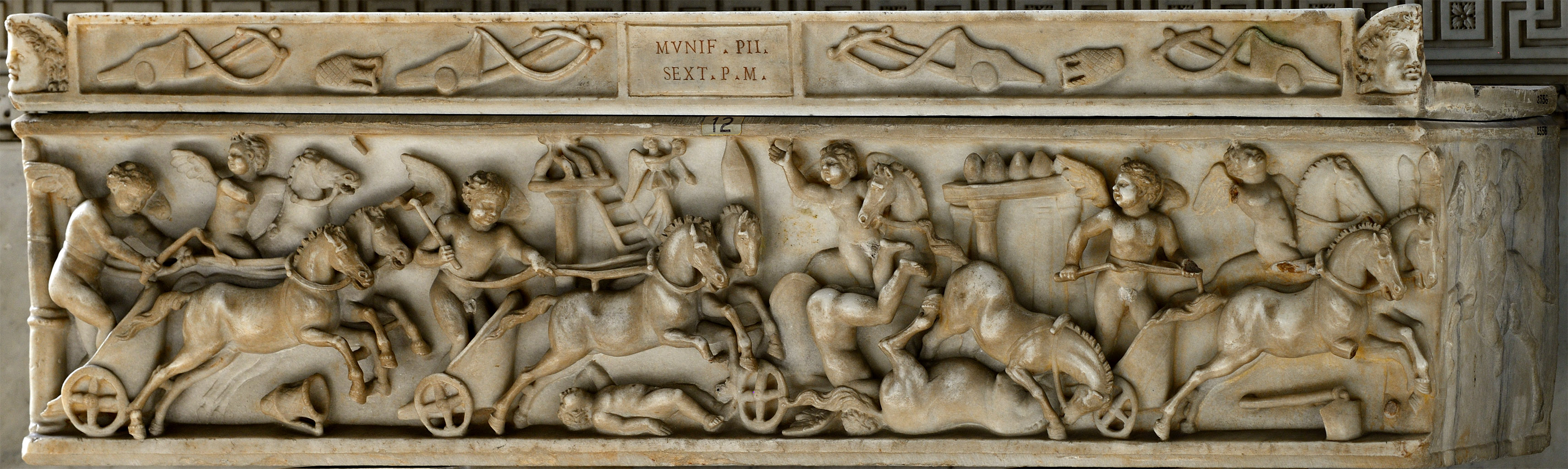 Sarcophagus of a child with a chariot race of Amors (front panel). Marble. 130—192 CE. Inv. No. 2356. Rome, Vatican Museums, Pius-Clementine Museum, Room of the Biga, 12