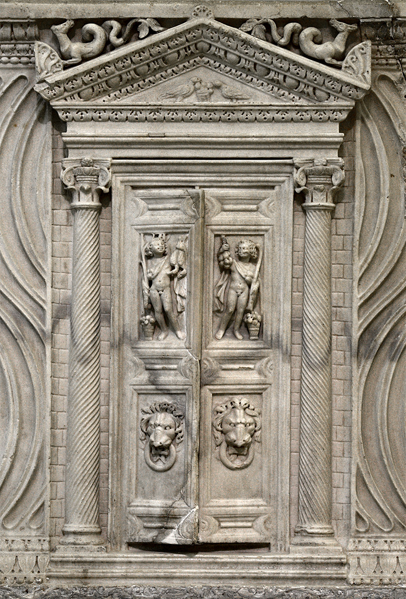 Sarcophagus with strigillated ornamentation and central gates (the front panel — close up). Marble. Early 3rd cent. CE. Inv. No. A 183. Saint Petersburg, The State Hermitage Museum