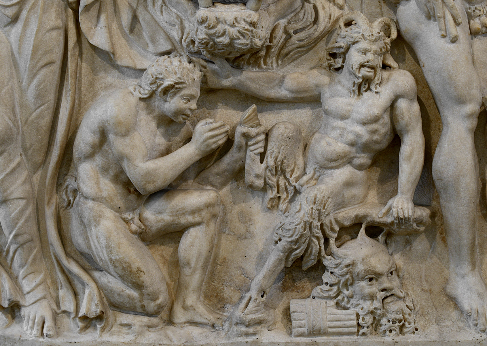Satyr removing a splinter from a Pan's foot. A close-up of side 1 of sarcophagus with Dionysiaс scenes. Marble. Ca. 210 CE. Inv. No. II 1a 231. Moscow, the Pushkin Museum of Fine Arts