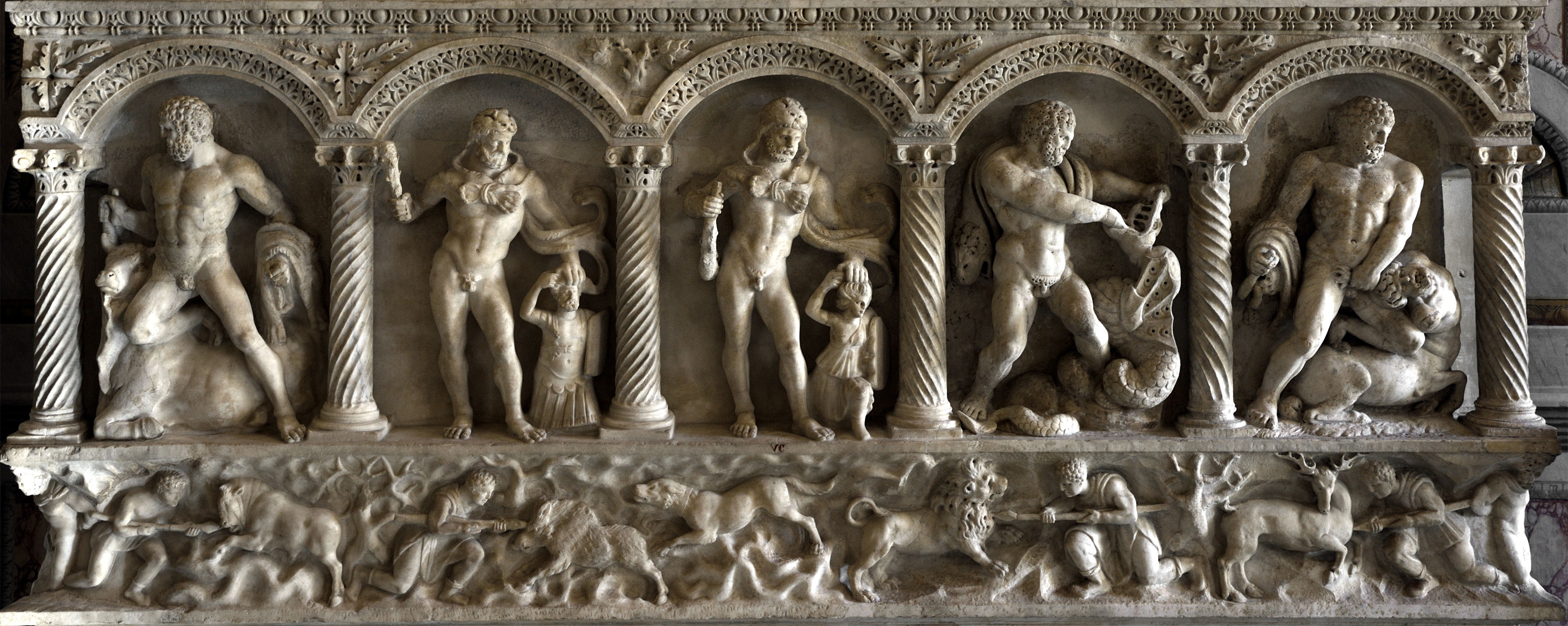 Rear of columnar sarcophagus showing the Labours of Heracles and scenes of hunt. Marble. Upper register: modern work imitating the composition of the front panel (17th cent.). Lower register: 160 CE.  Inv. No. VC. Rome, Museum and Gallery of Villa Borghese, Room II