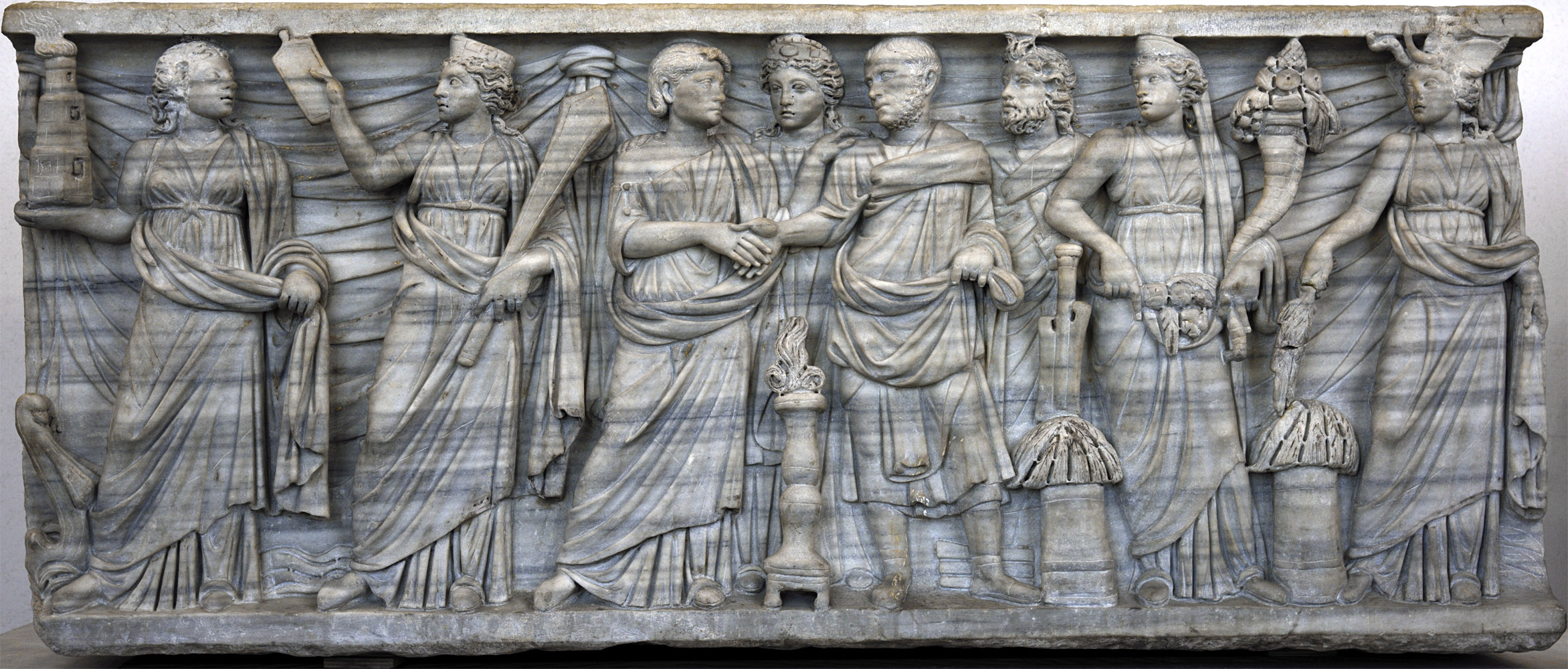 Sarcophagus of a married couple with personifications of Portus, Annona, Concordia, Genius Senati, Abundantia and Africa. Front panel. Marble. 270—280 CE. Rome, Roman National Museum, Palazzo Massimo alle Terme