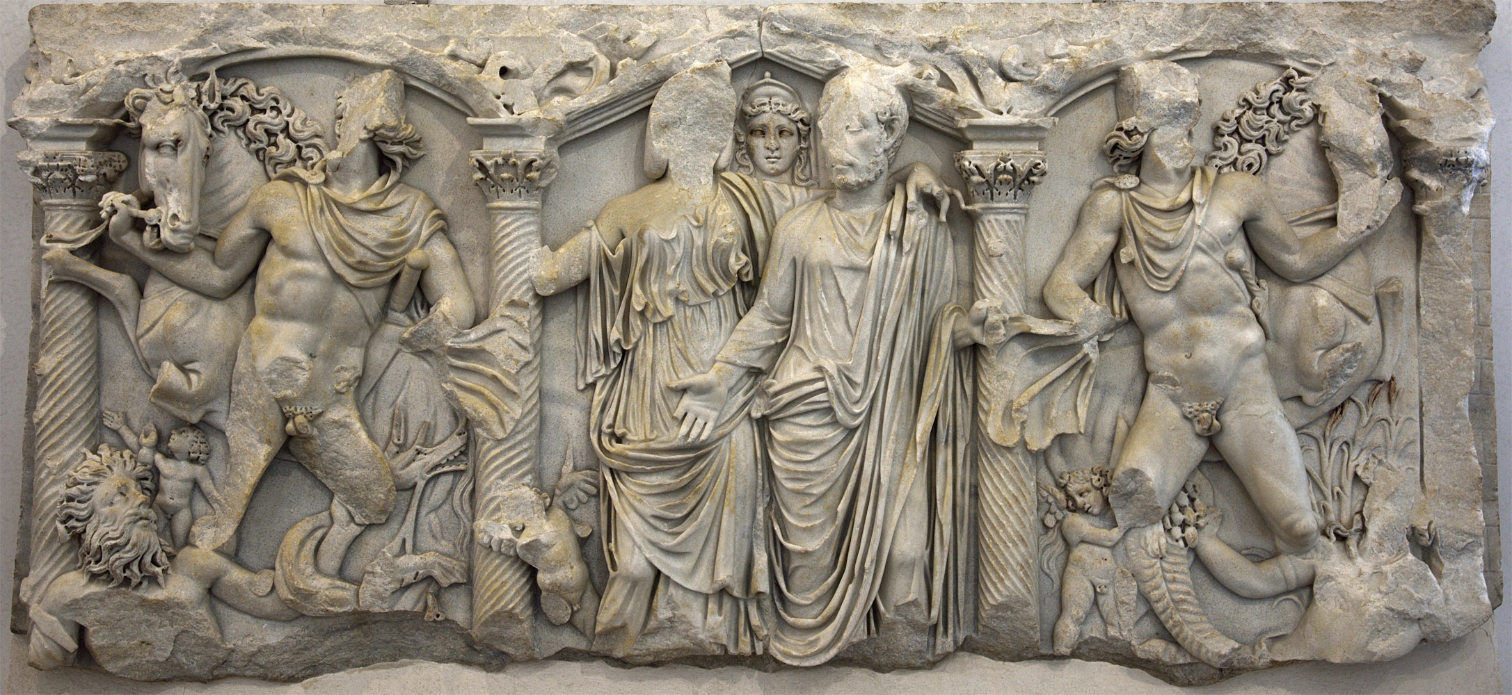 Sarcophagus of a married couple with Dioscuri. Front panel. Marble. 240—260 CE. Rome, Roman National Museum, Palazzo Massimo alle Terme