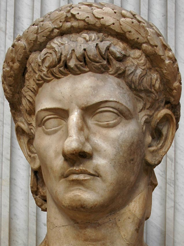 Head of Claudius wearing the civic wreath. Detail Marble. 1st century. Inv. No. 242. Rome, Vatican Museums, Pius-Clementine Museum, Round Room, 18