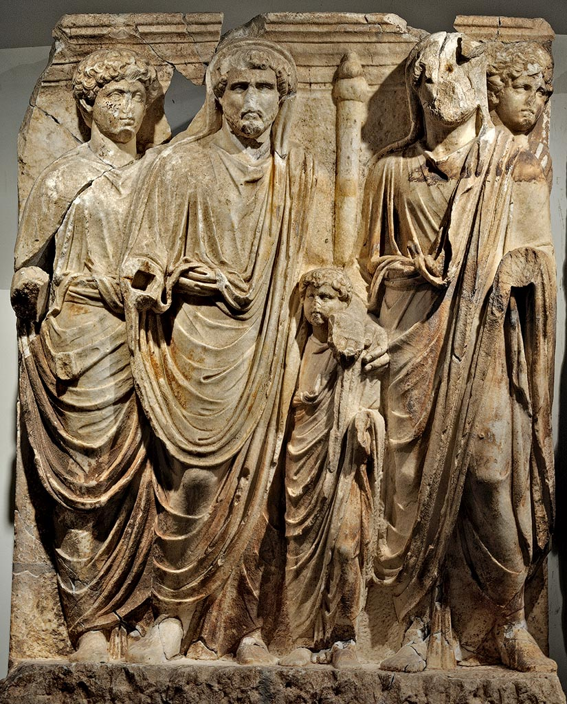 "Marcus Aurelius, Antoninus Pius, small Lucius Verus and Hadrian. A scene of a cycle ""Adoption"" of the Parthian frieze from Ephesos. Dolomitic marble from Thasos. After 169 (166?) CE. Vienna, Ephesos Museum"
