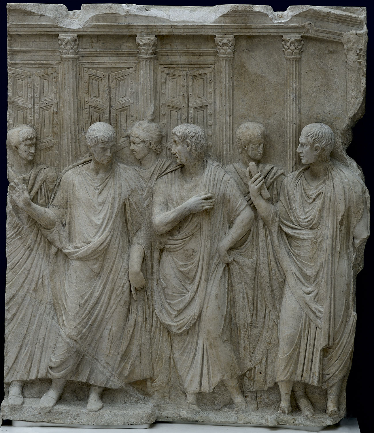 "Togate figures before the Temple of Jupiter Optimus Maximus Capitolinus. Right panel of the relief ""Sacrifice in Front of the Temple of Juppiter Capitolinus."" Marble. Ca. 118—125 CE.  Inv. No. MR 792 (MA 1089). Paris, Louvre Museum"