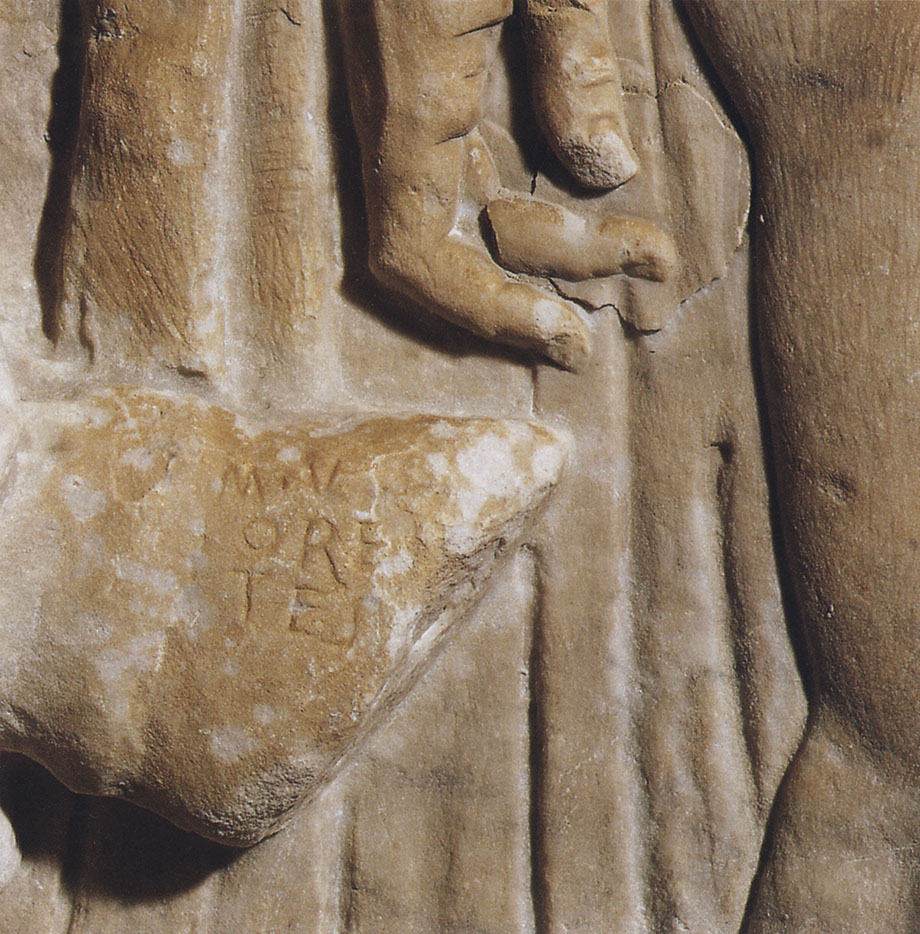 """Left panel of the relief """"Sacrifice in front of the Temple of Juppiter Capitolinus."""" Detail: signature of the sculptor Marcus Ulpius Orestus. CIL VI 29800. Grey marble. First quarter of the 2nd CE. Inv. No. MR 737 (MA 978). Paris, Louvre Museum"""