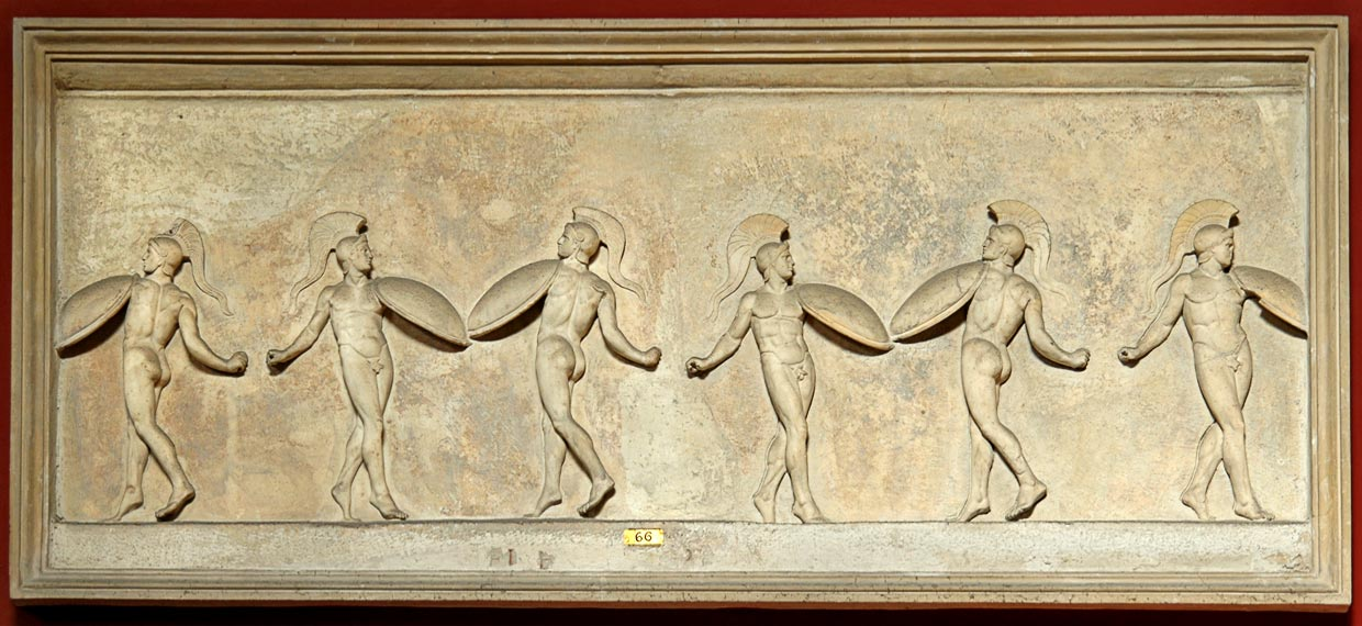 Relief with dancing warriors. Marble. Roman copy of the late republican era after a classic Greek model. Inv. No. 321. Rome, Vatican Museums, Pius-Clementine Museum, Room of the Muses, 66