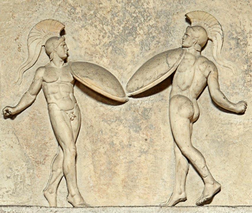 Relief with dancing warriors. Detail. Marble. Roman copy of the late republican era after a classic Greek model. Inv. No. 321. Rome, Vatican Museums, Pius-Clementine Museum, Room of the Muses, 66