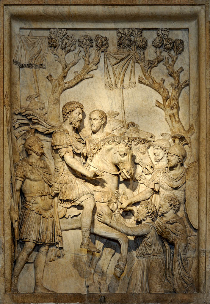 The clemency of the emperor. Relief panel from a triumphal arch of Marcus Aurelius (presumably). Marble. 177—180 CE.  Inv. No. MC 809. Rome, Capitoline Museums, Palazzo dei Conservatori, Monumental Staircase