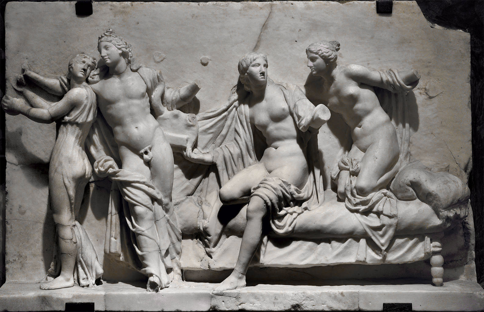 Alcibiades and hetaerae (Apollo and three nymphs). Marble. First half of the 1st cent. CE. H. 45 cm, W. 53 cm. Inv. No. 6688. Naples, National Archaeological Museum