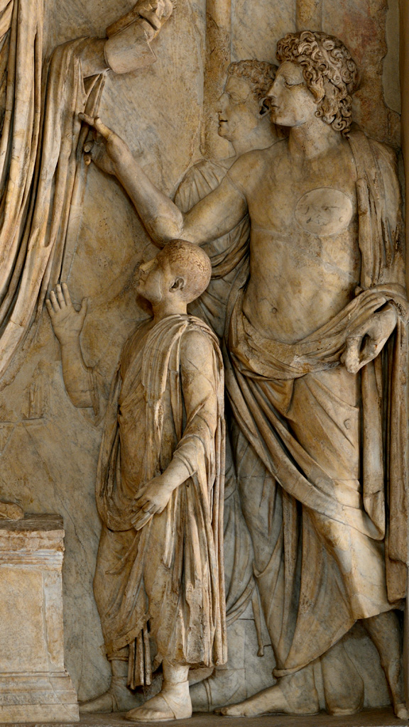 Donation of food to Roman children. Detail. Relief panel from the so-called the Arch of Portugal on via Lata. Marble. 2nd cent. CE. Inv. No. MC 832. Rome, Capitoline Museums
