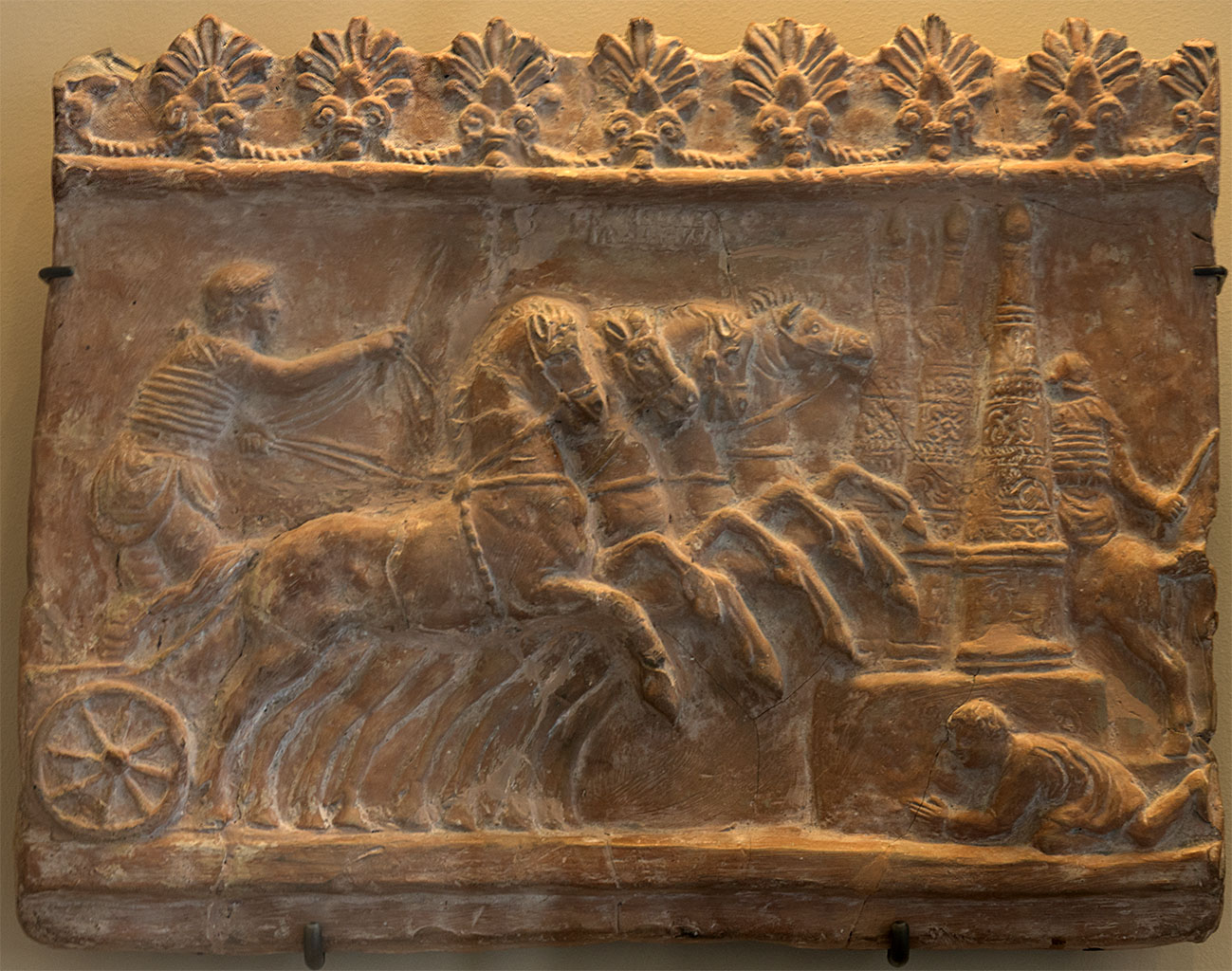 Campana tile with a relief scene of chariot race. Terracotta. 1st century CE. Inv. No. S 877. Paris, Louvre Museum