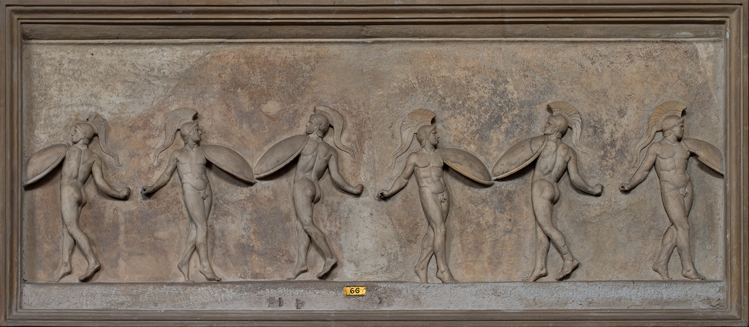 Relief with dancing warriors. Marble. Neo-Attic work of the first half of the 1st cent. BCE after an Athenian relief of the second half of 4th cent. BCE. Inv. No. 321. Rome, Vatican Museums, Pius-Clementine Museum, Room of the Muses, 66