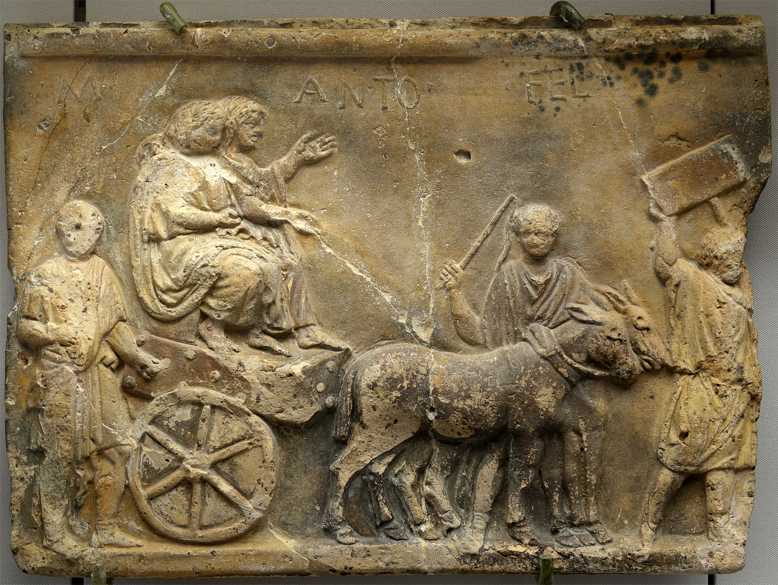 Campana plaque showing two grieving male prisoners being drawn on a cart in a triumphal procession. Terracotta, traces of paint. 1st cent BCE. Inv. No. AT 3712. Moscow, the Pushkin Museum of Fine Arts