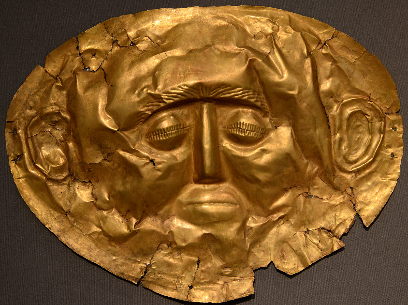 Funeral mask. Hammered golden sheet. 1550—1500 BCE. Inv. No. 253. Athens, National Archaeological Museum