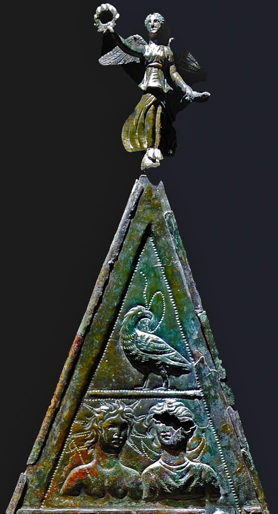 Double-sided triangular votive bronze tablet dedicated to Jupiter Dolichenus (3d and 4th registers, top figure). Bronze, chasing. Inv. No. M4. Vienna, Museum of Art History