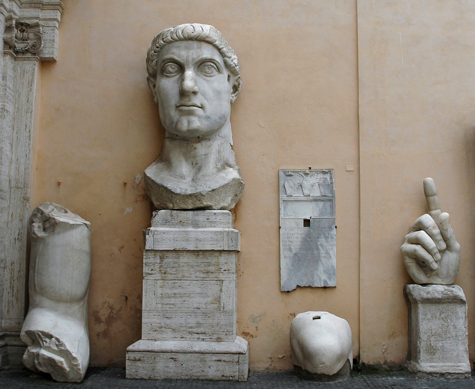 Parts of the colossus of Constantine. Marble. 312—315. Rome, Capitoline Museums, Palazzo dei Conservatori, Courtyard