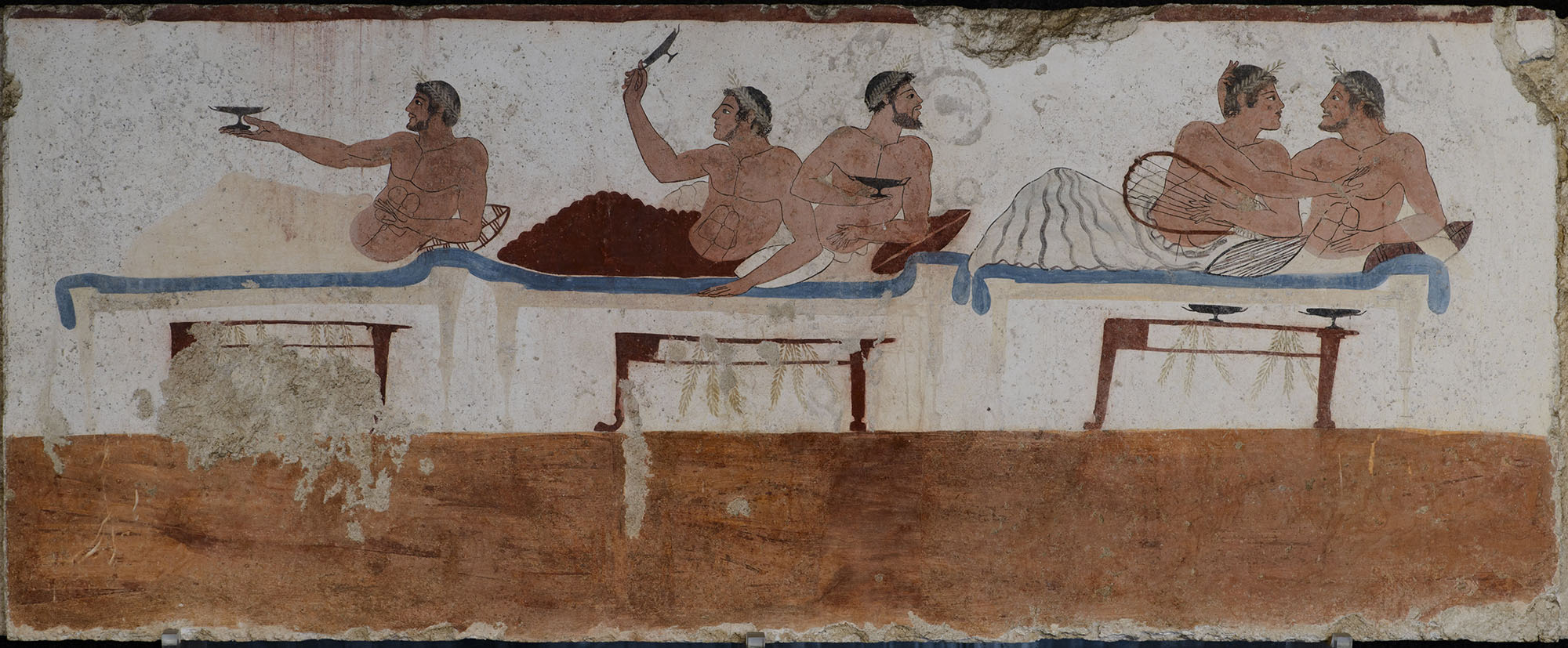 Fragment of scene of the symposium. The inside north wall of sarcophagus from Tomb of the Diver. Fresco. Ca. 480 BCE. Paestum, National Archaeological Museum