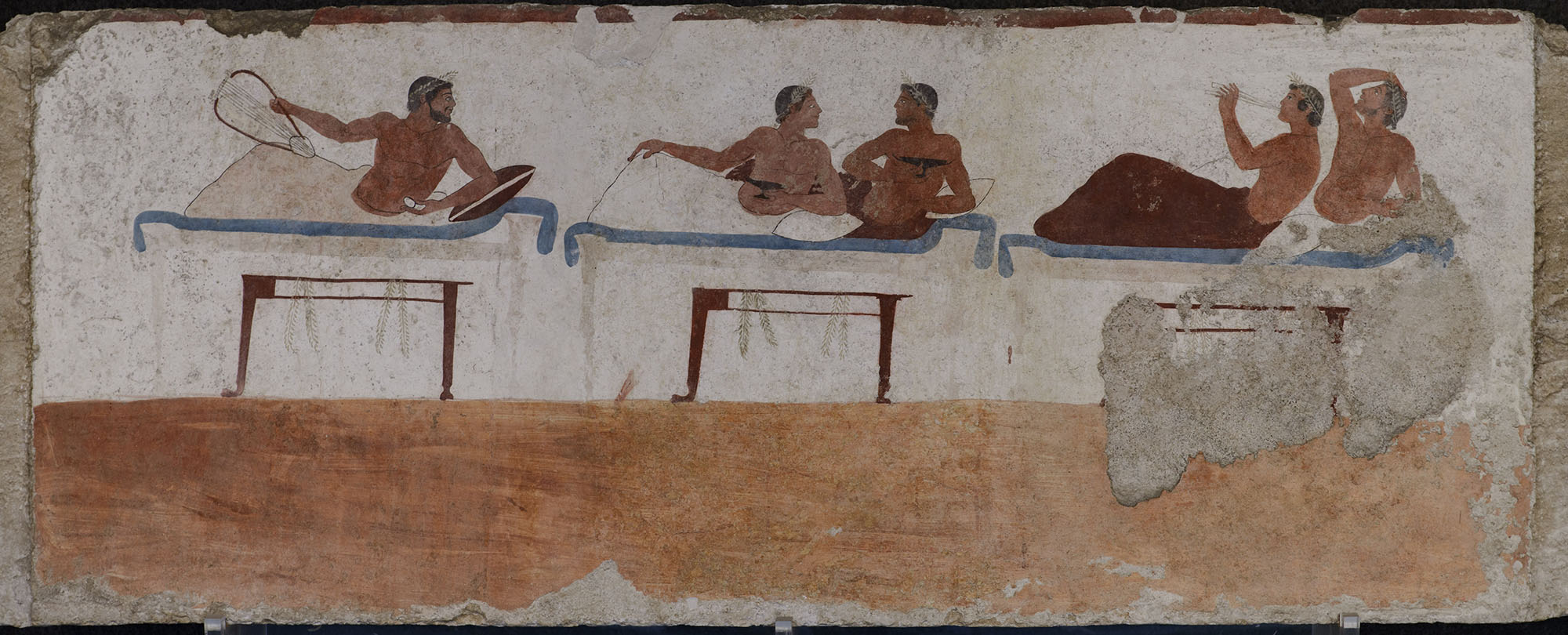Fragment of scene of the symposium. The south inside wall of sarcophagus from Tomb of the Diver. Fresco. Ca. 480 BCE. Paestum, National Archaeological Museum