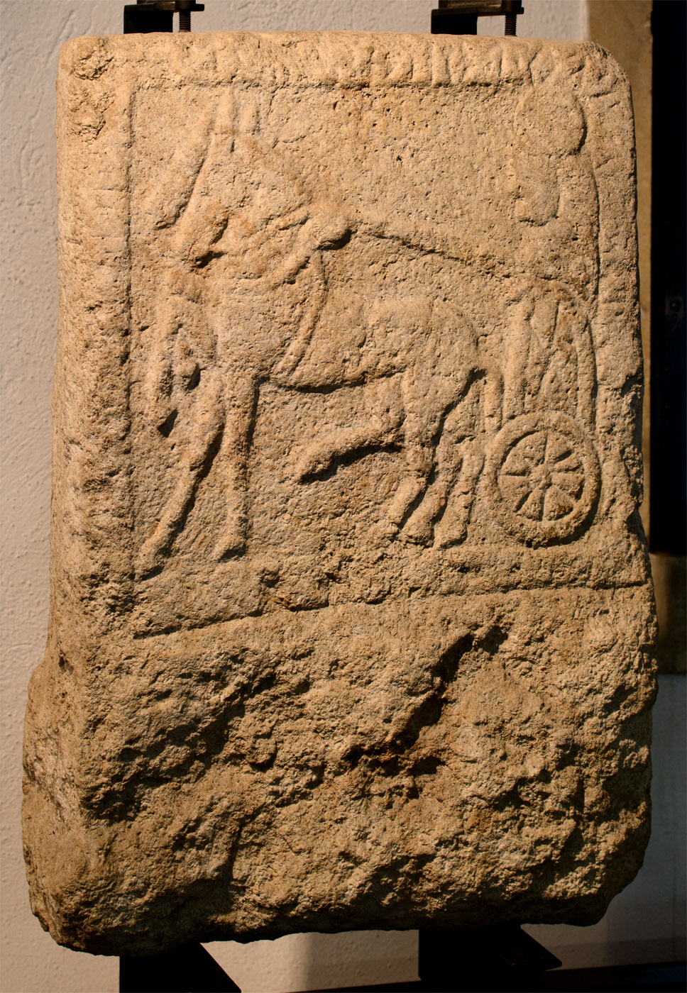 A funerary stele depicting voyage of the deceased to the afterworld. Limestone. 5th cent. BCE. Padova, Archaeological Museum