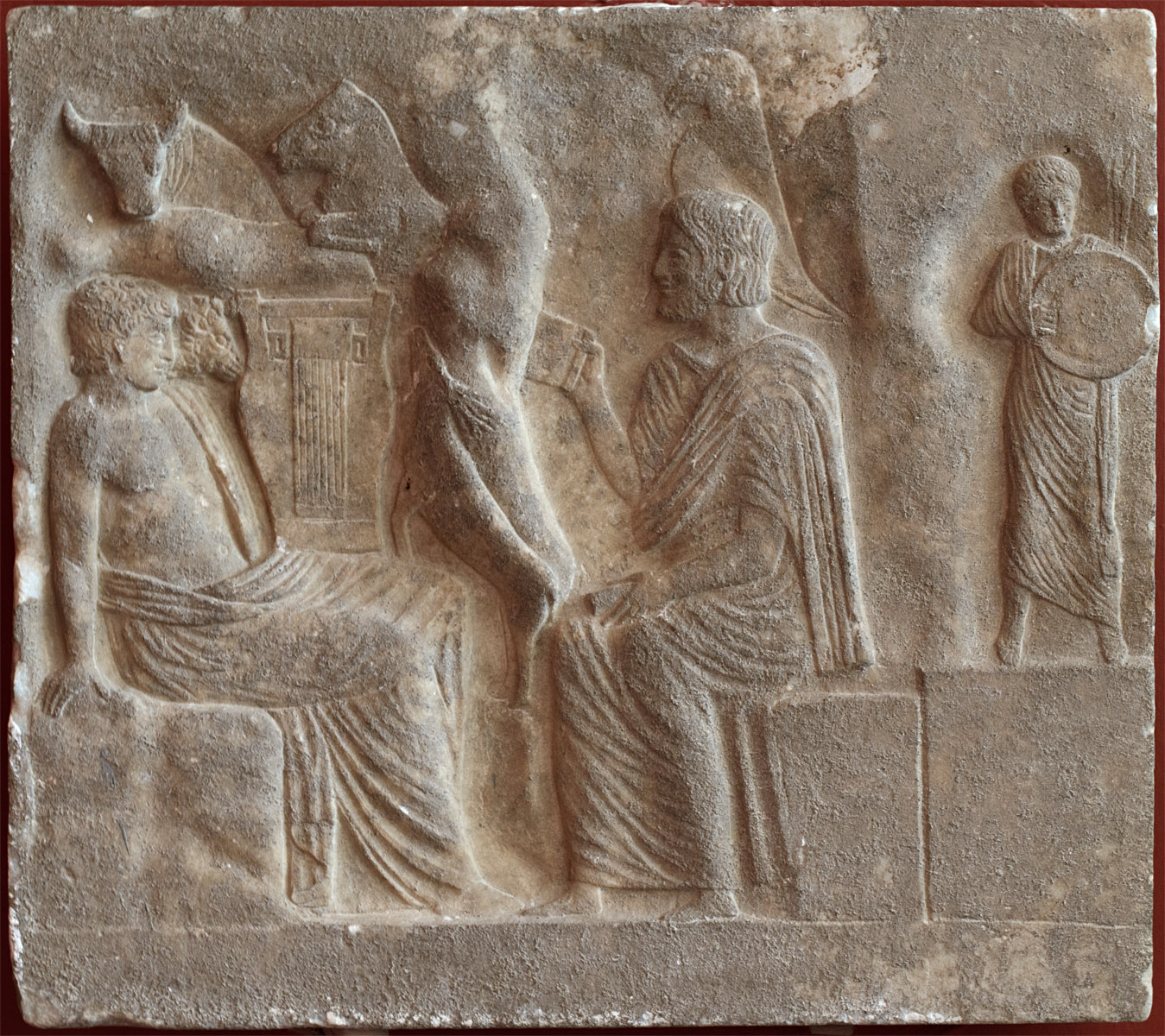 Relief depicting Orpheus seating with a lyre and a poet offering him a rolled manuscript. 1st cent. CE. Sparta, Archaeological Museum