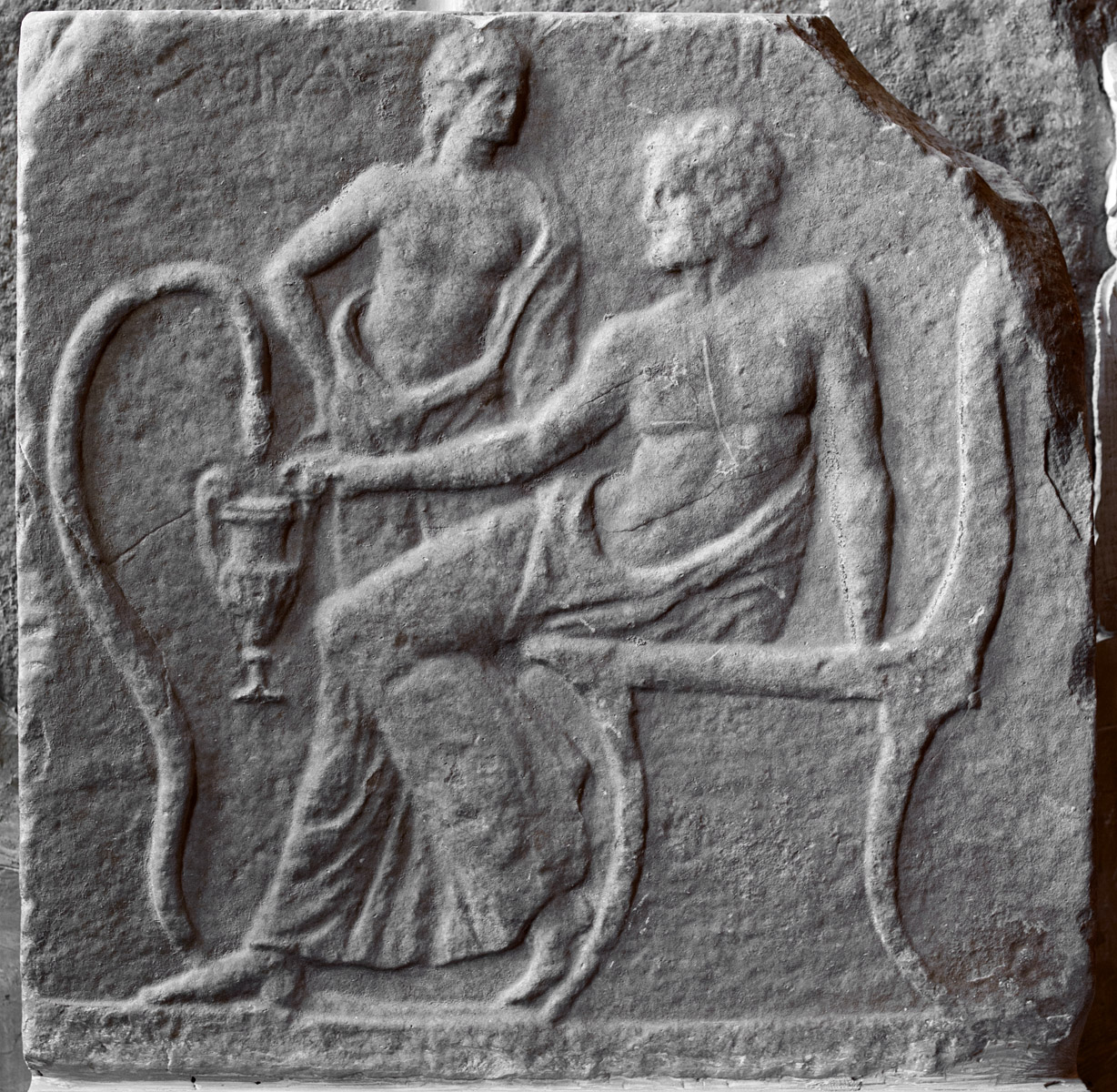 Funerary Laconian inscribed relief depicting a pair of men, probably, a heroized deceaseds. 3rd cent. BCE. Inv. No. 3360. Sparta, Archaeological Museum