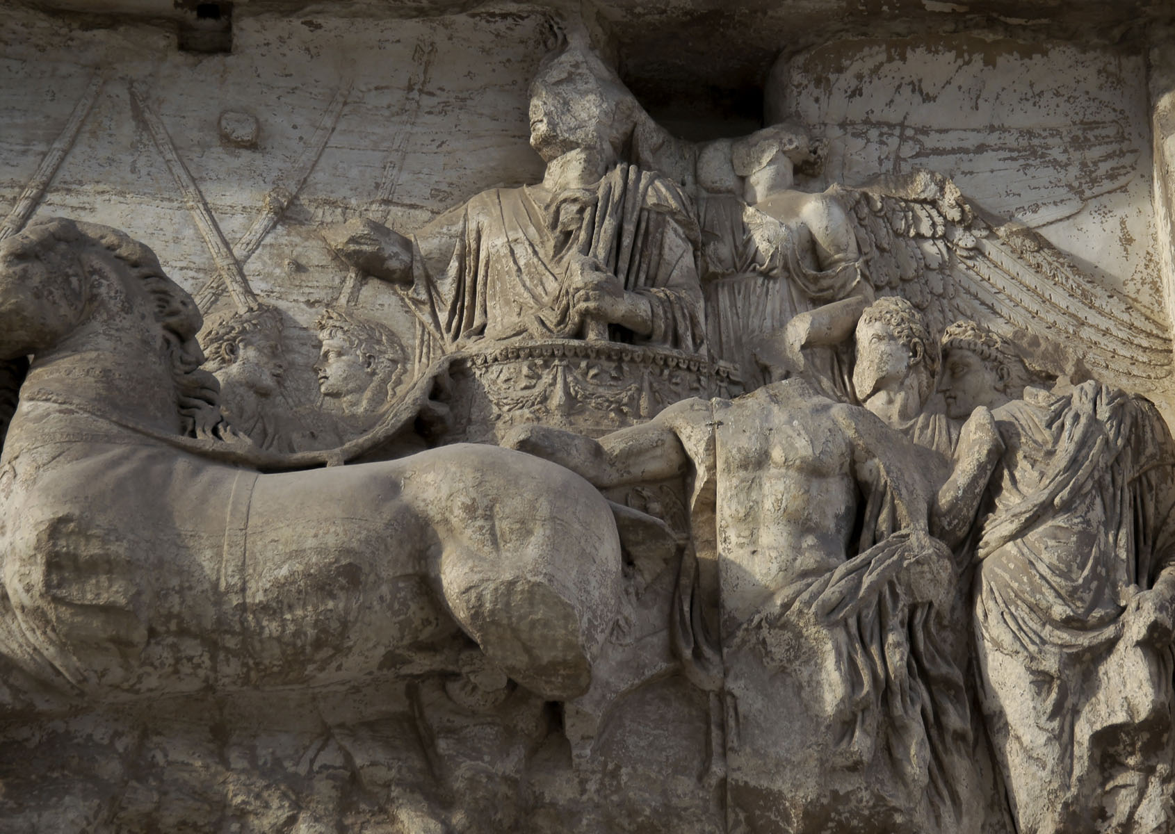 Triumphal procession of Titus. Detail: Titus and Victory. Relief on the northern side of the arch of Titus. 81—96 CE. Rome, Roman Forum, Arch of Titus