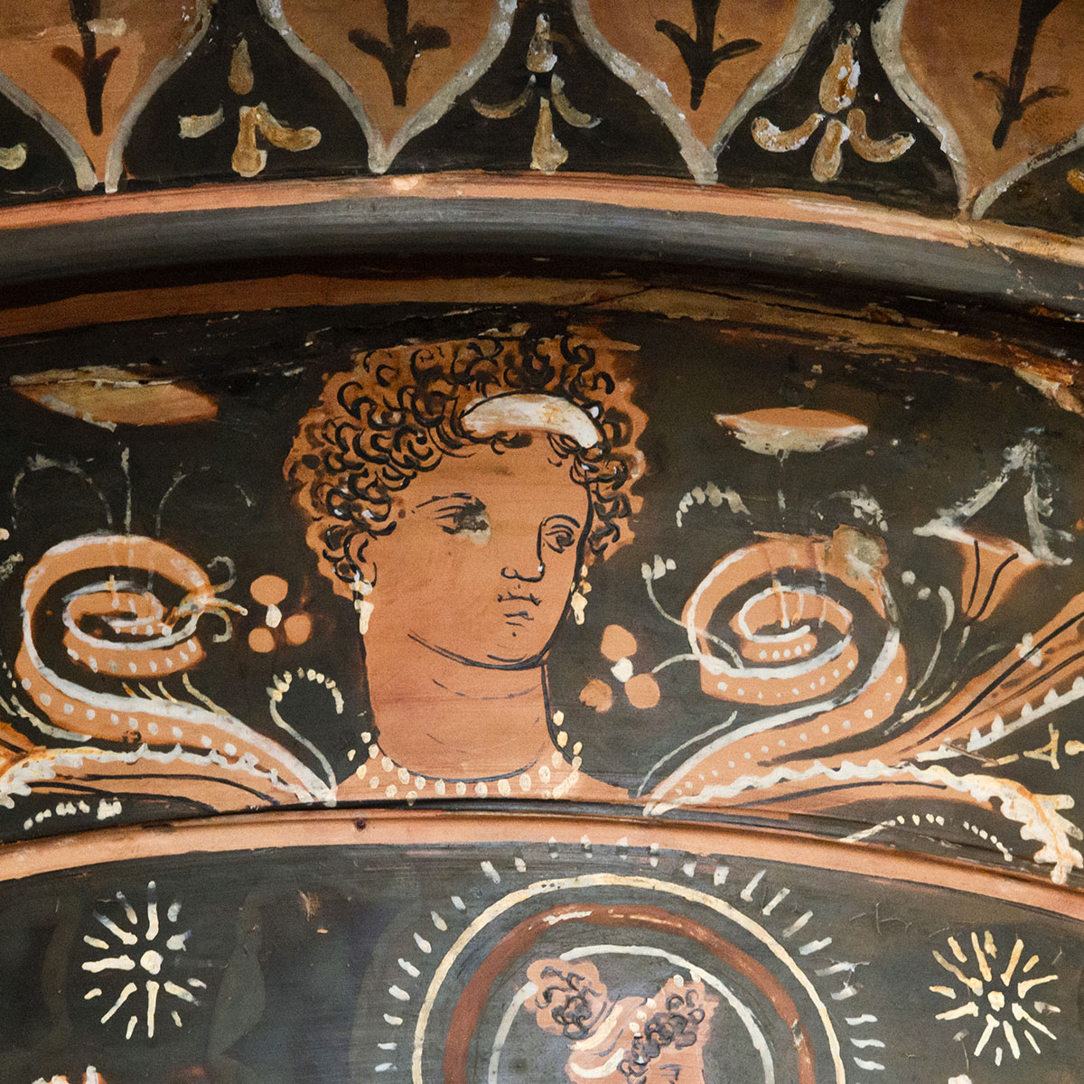 Volute-krater depicting the journey of Orpheus to the Underworld. Detail: a female head. Red-figured volute-krater. Apulia. Attributed to The Underworld Painter. Clay. Ca. 330—310 BCE. Munich, State Antique Collection