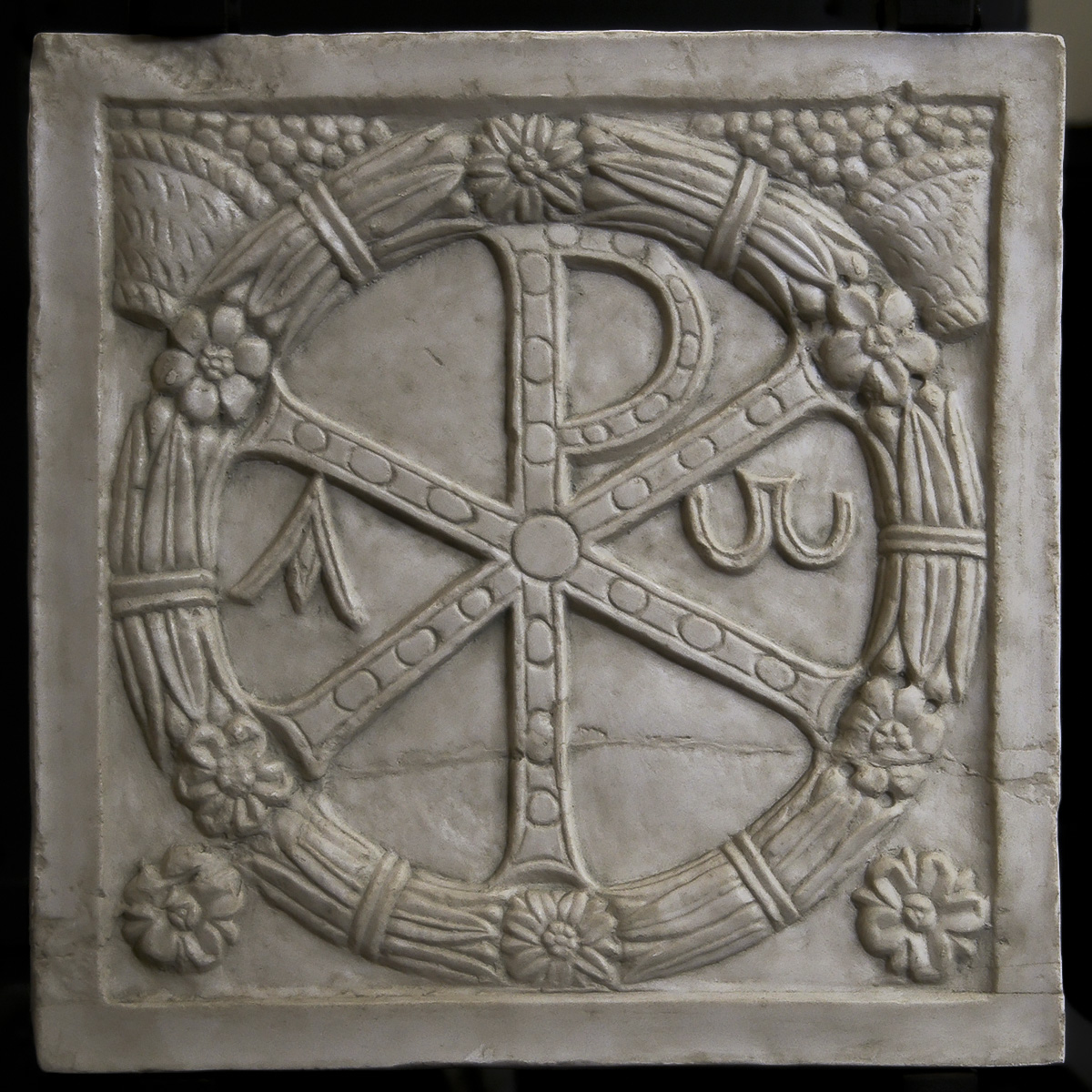 The Christ monogram. Central fragment of the frontal side of a strigillated sarcophagus. End of the 4th cent. CE. Inv. No. 31550 (ex 188). Rome, Vatican Museums, Pio-Christian Museum