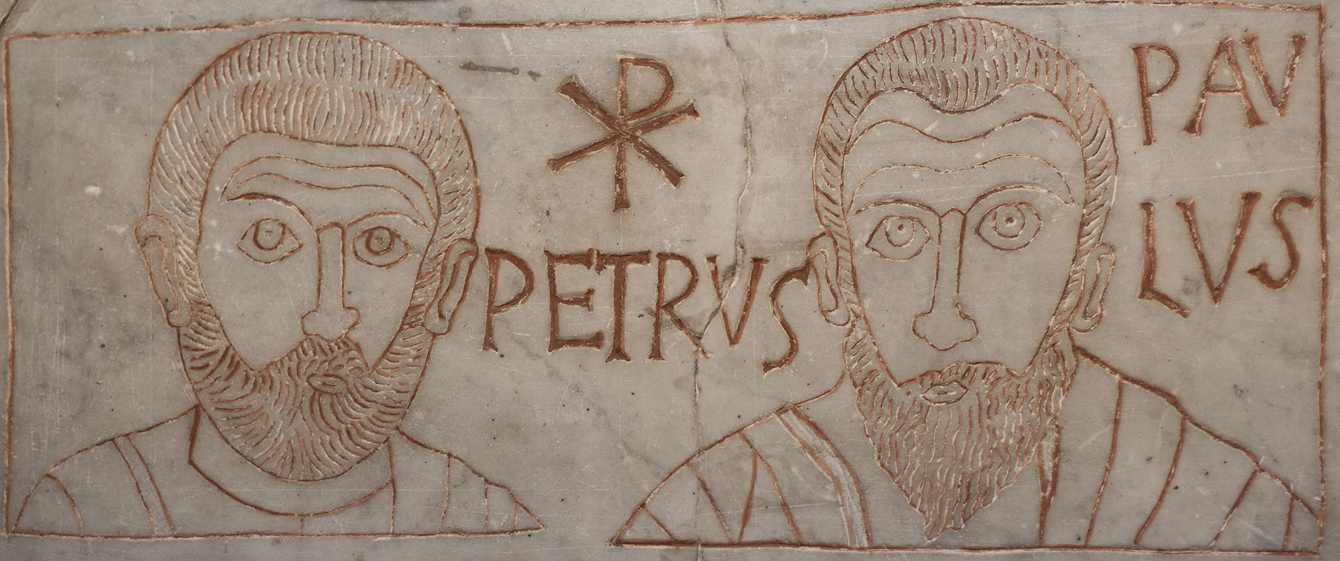 Slab used to close a child funerary niche (loculus) in a catacombs. Detail: Saint Apostles Peter and Paul. Marble. 4th cent. CE. Inv. No. 28596. Rome, Vatican Museums, Pio-Christian Museum