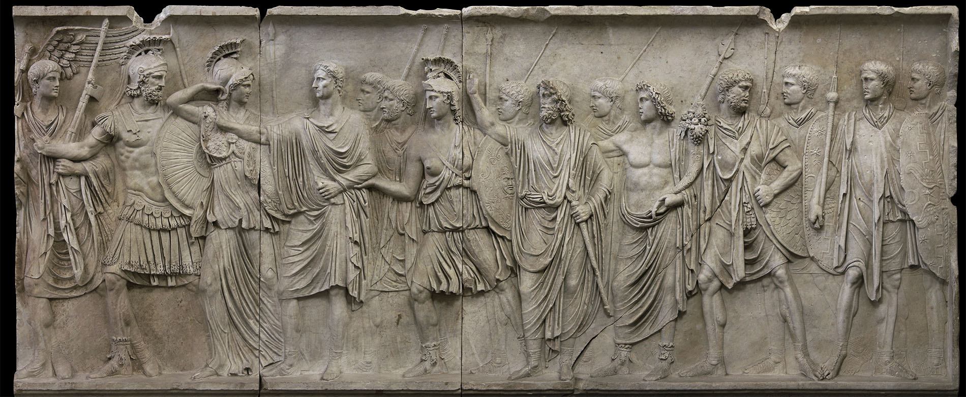 Departure of the emperor from Rome for a military campain (profectio). Relief A from Palazzo Cancelleria in Rome. Luna marble. 81—96 CE.  Rome, Vatican Museums, Gregorian Profane Museum