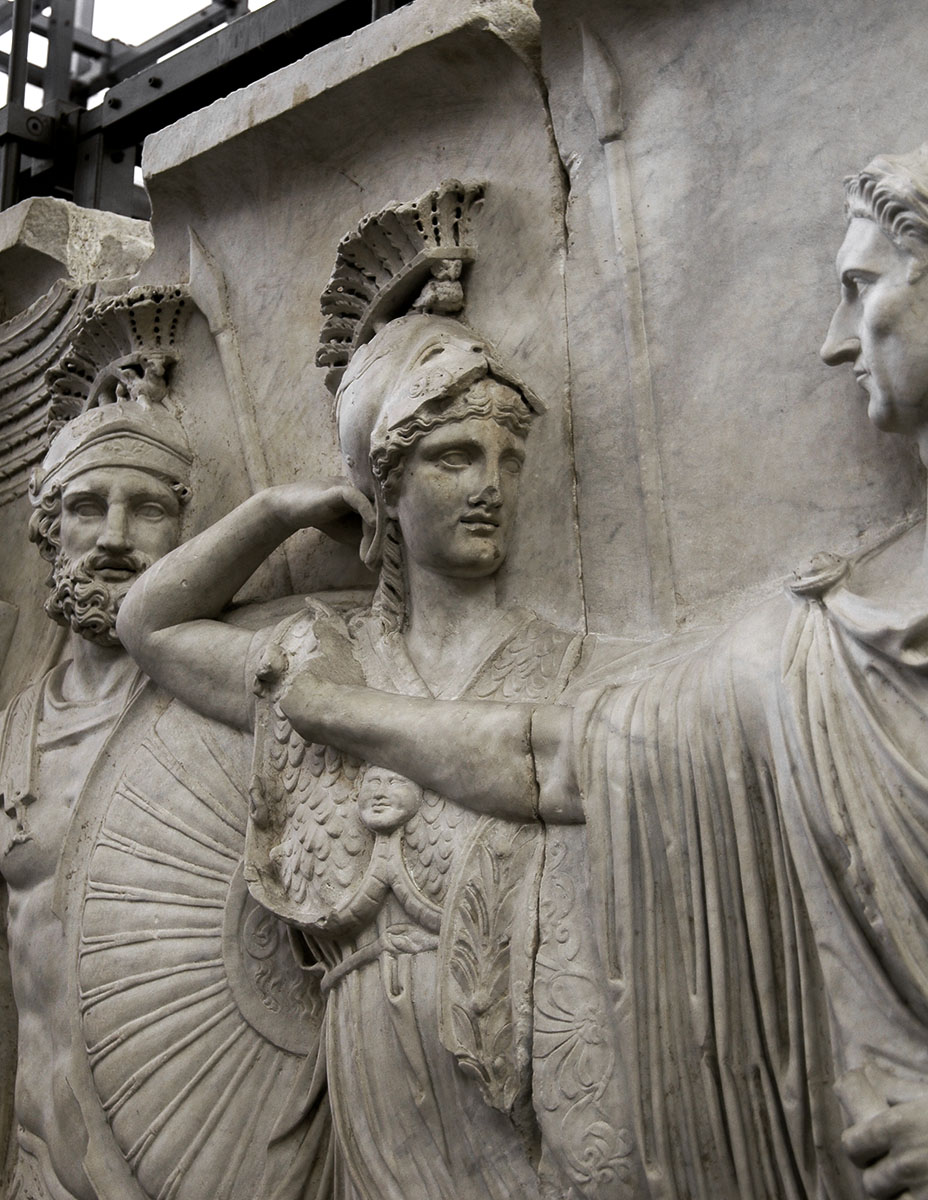 Departure of the emperor from Rome for a military campain (profectio). Detail: Minerva. Relief A from Palazzo Cancelleria in Rome. Luna marble. 81—96 CE. Rome, Vatican Museums, Gregorian Profane Museum