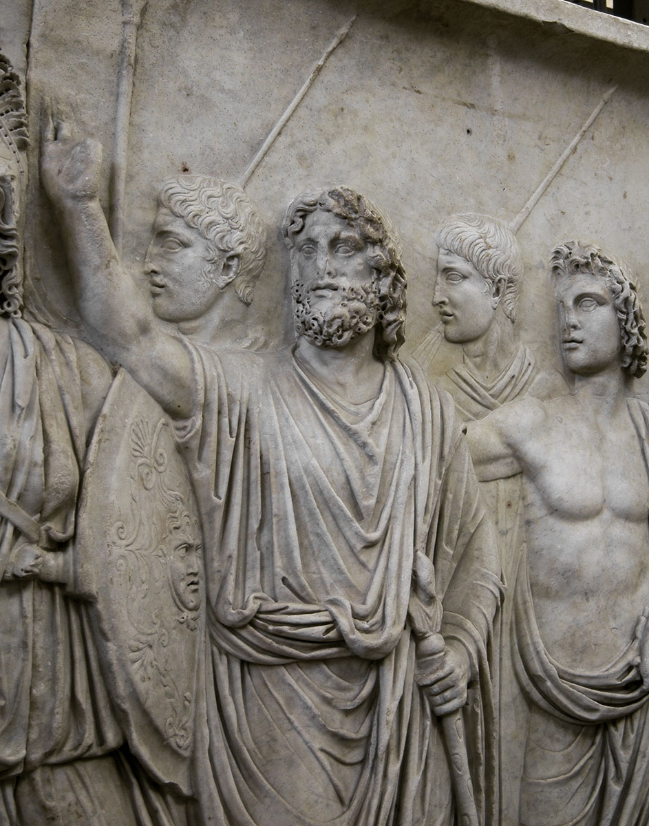 Departure of the emperor from Rome for a military campain (profectio). Detail: Genius Senatus. Relief A from Palazzo Cancelleria in Rome. Luna marble. 81—96 CE. Rome, Vatican Museums, Gregorian Profane Museum