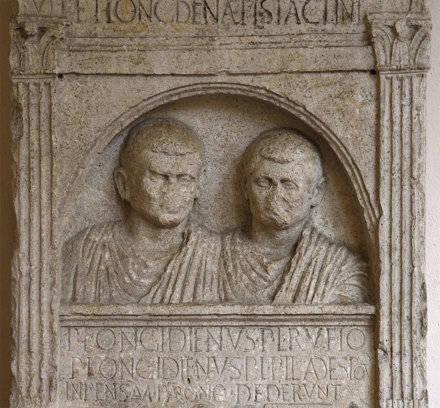 """Funerary stele containing a portrait busts and a scene of shipbuilding (""""the Longidien stele""""). The medium register. Limestone. First half of the 1st century CE (the museum dating). Inv. No. 7. Ravenna, National Museum, First cloister"""